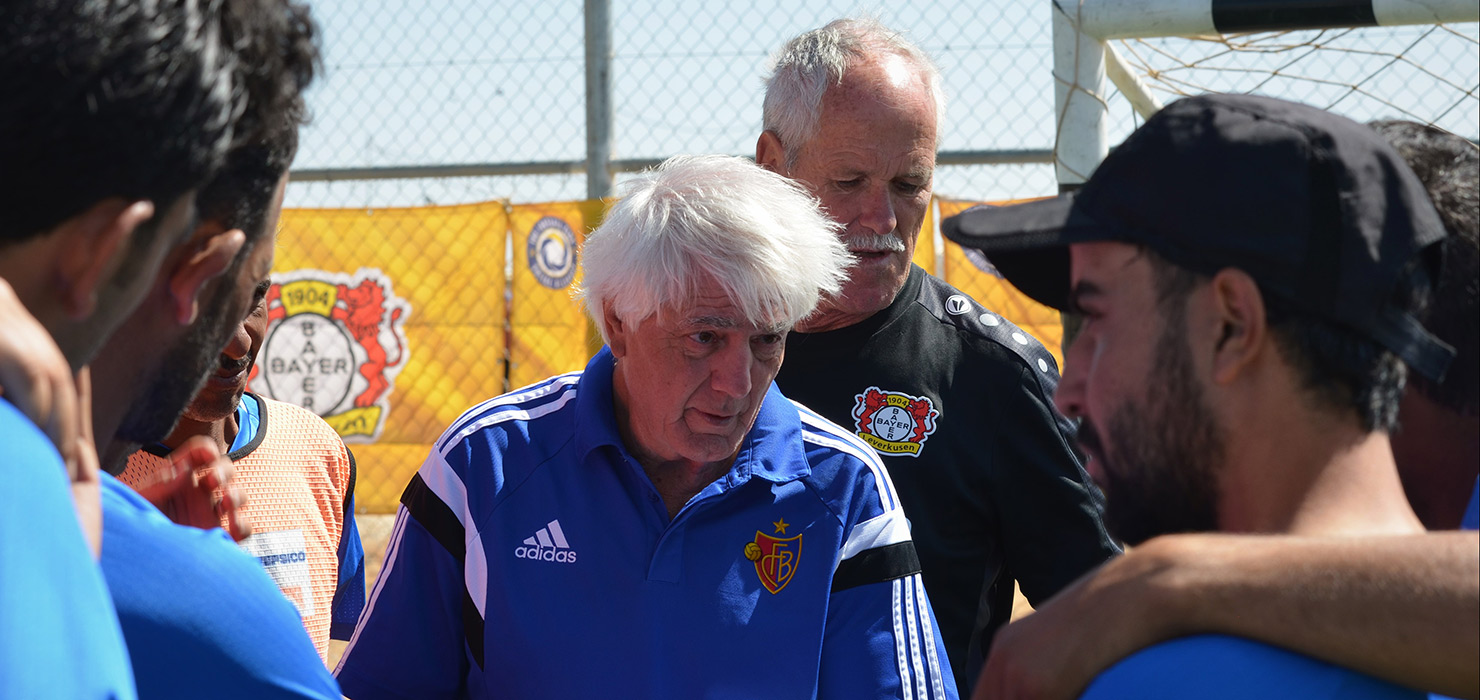 Two instructors are explaining something to the Young Coaches